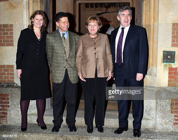 British Prime Minister Gordon Brown and his wife Sarah pose with German Chancellor Angela Merkel and her husband Joachim Sauer at Chequers near...