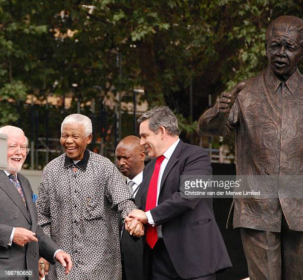 CONTENT] British Prime Minister Gordon Brown and Lord Attenborough lead Nelson Mandela former president of South Africa back to his seat after he...