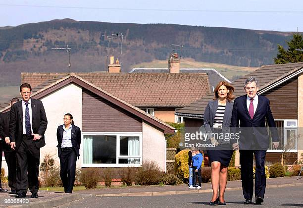 British Prime Minister Gordon Brown and wife Sarah Brown arrive to meet locals on a residential street in Lochgelly during the Labour Party's...