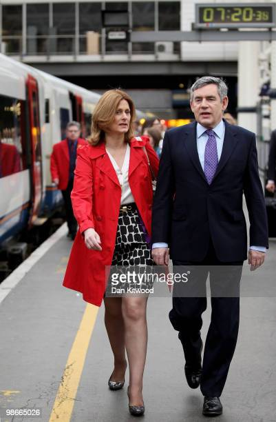 British Prime Minister Gordon Brown and wife Sarah Brown prepare to board a train at Waterloo Station ahead of a day along the South coast on the...