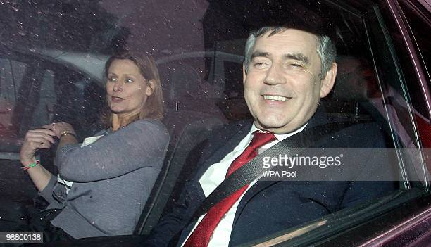 British Prime Minister Gordon Brown and wife Sarah leave the North London Tavern after Liberal Demcrat supporters blocked forced him to leave through...