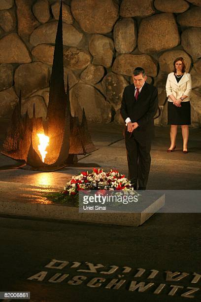 British Prime Minister Gordon Brown lays a wreath beside the eternal flame in the Hall of Remembrance during a visit to the Yad Vashem Holocaust...