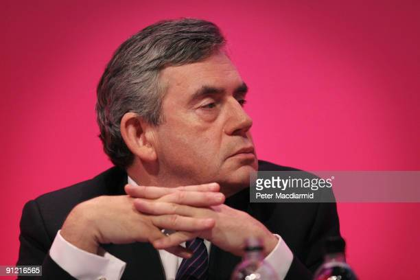 British Prime Minister Gordon Brown listens to Chancellor of the Exchequer Alistair Darling speaking at The Labour Party Conference on September 28...