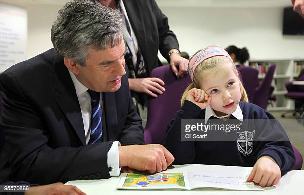 British Prime Minister Gordon Brown meets school child Nicole Alves who receives one-to-one tuition in maths and English on January 4, 2010 in...