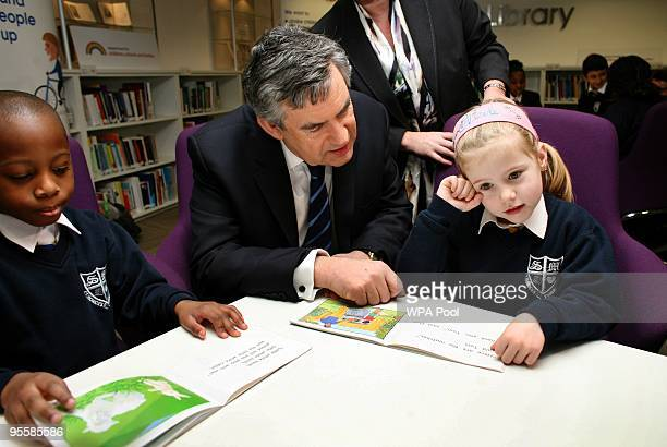 British Prime Minister Gordon Brown meets school children, Emmanuel Odmuso aged 6 and Nicole Alvis aged 5 from St Monica's Roman Catholic school in...