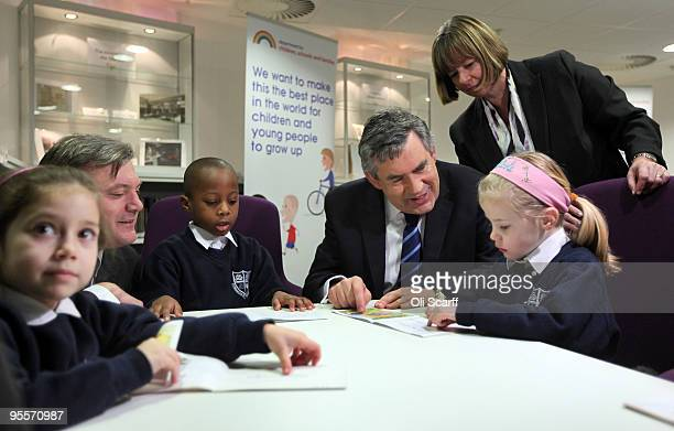 British Prime Minister Gordon Brown meets school children Nicole Alves and Emmanuel Odmuso who receive one-to-one tuition in maths and English on...