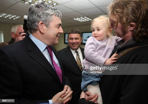 British Prime Minister Gordon Brown meets with Eva Mansfield aged 3 and her father Paul Mansfield at Abby Couriers on May 3 2010 in Basildon England...