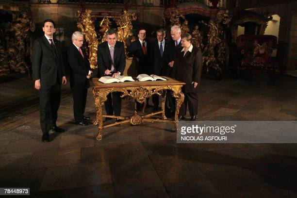 British Prime Minister Gordon Brown sign the ''Treaty of Lisbon'' next to his Secretary of State for Foreign and Comonwealth Affairs David Miliband...