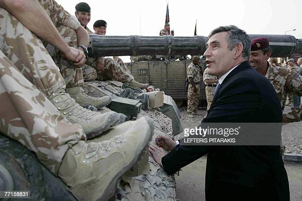 British Prime Minister Gordon Brown signs an autograph on a tank during his visit to British troops at their base in the southern city of Basra, 550...