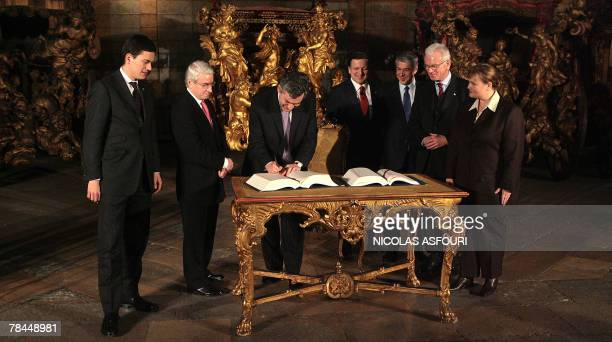 British Prime Minister Gordon Brown signs the ''Treaty of Lisbon'' next to his Secretary of state for Foreign and Comonwealth Affairs David Miliband...