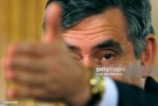 British Prime Minister Gordon Brown speaks during a conference at 10 Downing Street in London, on October 8, 2008. Britain's government Wednesday...