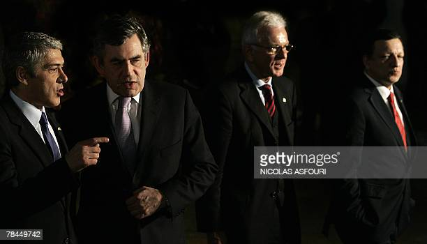 British Prime Minister Gordon Brown speaks with Portuguese Prime Minister Jose Socrates after he signed the Treaty of Lisbon as they walk together...