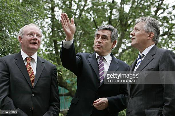 British Prime Minister Gordon Brown talks with Northern Ireland's First Minister Peter Robinson and Northern Ireland's Deputy First Minister Martin...
