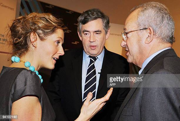 British Prime Minister Gordon Brown talks with web entrepreneur Martha Lane Fox and Lord Sainsbury who have an advisory role to Government in London...