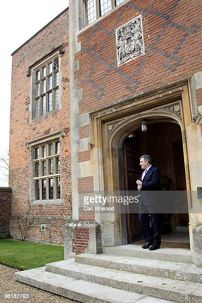 British Prime Minister Gordon Brown waits to greet German Chancellor Angela Merkel to Chequers the Prime Minister's official country residence on...