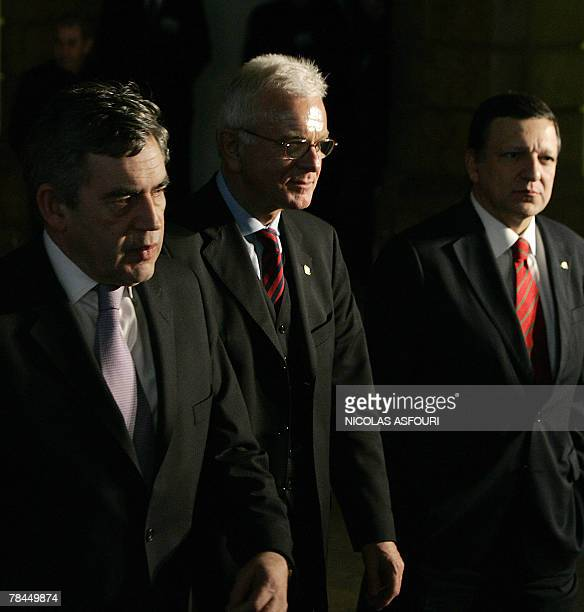 British Prime Minister Gordon Brown walks after he signed the ''Treaty of Lisbon'' next to European Commission President Jose Manuel Barroso and...
