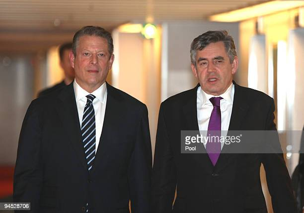 British Prime Minister Gordon Brown walks with Al Gore the former 45th Vice President of the United States during the COP15 United Nations Climate...