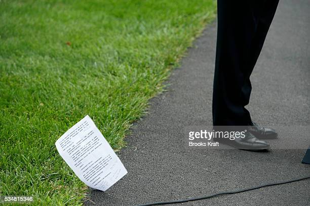 British Prime Minister Gordon Brown's notes blow to the ground during a joint press conference with President Bush at Camp David Maryland