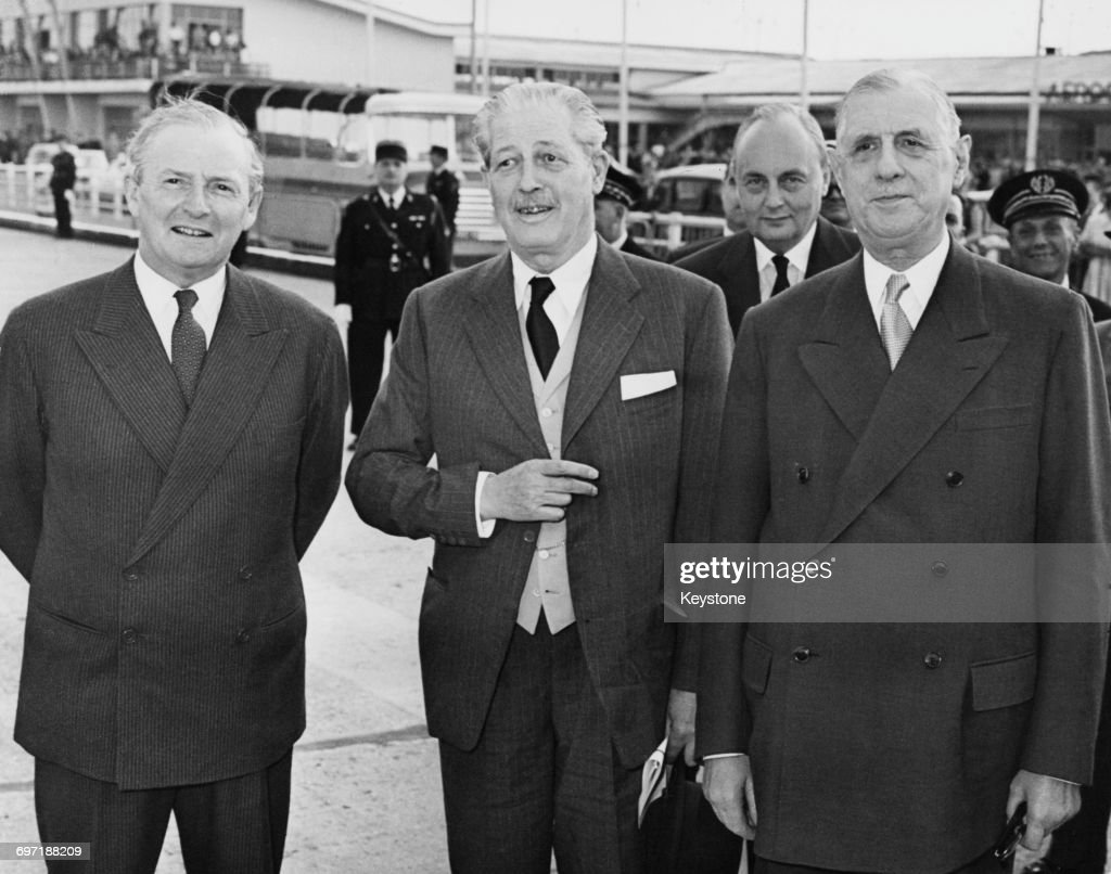 British Prime Minister Harold Macmillan (1894 - 1986, centre), and Foreign Secretary Selwyn Lloyd (1904 - 1978, left) on arrival at Orly Airport before talks with French Prime Minister Charles de Gaulle (1890 - 1970, right), Paris, 30th June 1958.