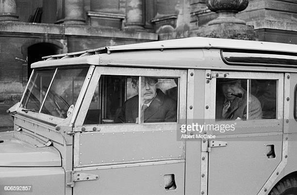 British Prime Minister Harold Macmillan at Blenheim Palace UK 11th November 1960 In the back of the vehicle is Henry Herbert 6th Earl of Carnarvon