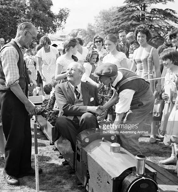 British Prime Minister Harold MacMillan drives a miniature railway engine at a toy fair in Bromley Kent where he is the local MP 21st August 1961