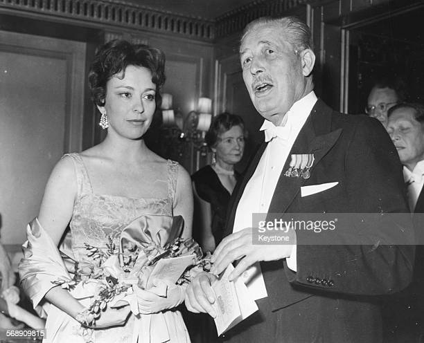 British Prime Minister Harold Macmillan meeting actress Helle Virkner at an AngloDanish Society Dinner at the Dorchester Hotel London May 10th 1961