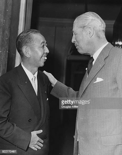 British Prime Minister Harold Macmillan saying goodbye to Japanese Prime Minister Nobusuke Kishi following a meeting at 10 Downing Street, London,...
