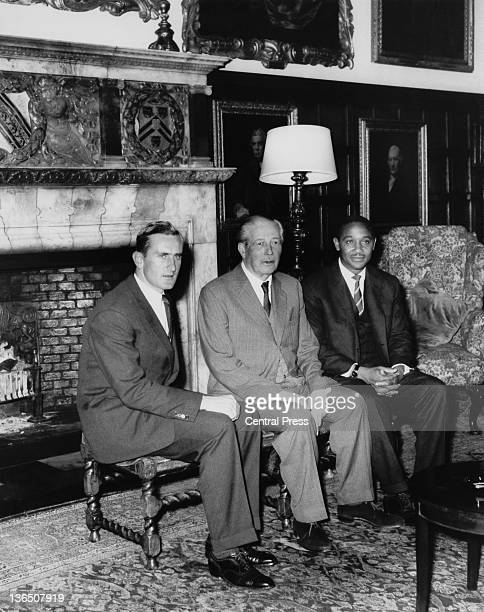 British Prime Minister Harold Macmillan with England Test cricket captain Ted Dexter and his West Indian counterpart Frank Worrell at Chequers in...
