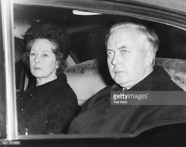 British Prime Minister Harold Wilson and his wife in the back of a car, arriving to see Sir Winston Churchill lying in state at Westminster Abbey,...