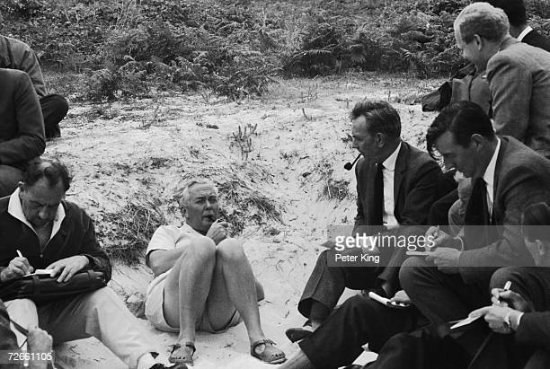 British Prime Minister Harold Wilson is interviewed by journalists during a holiday picnic on the island of Samson in the Scilly Isles 10th August...