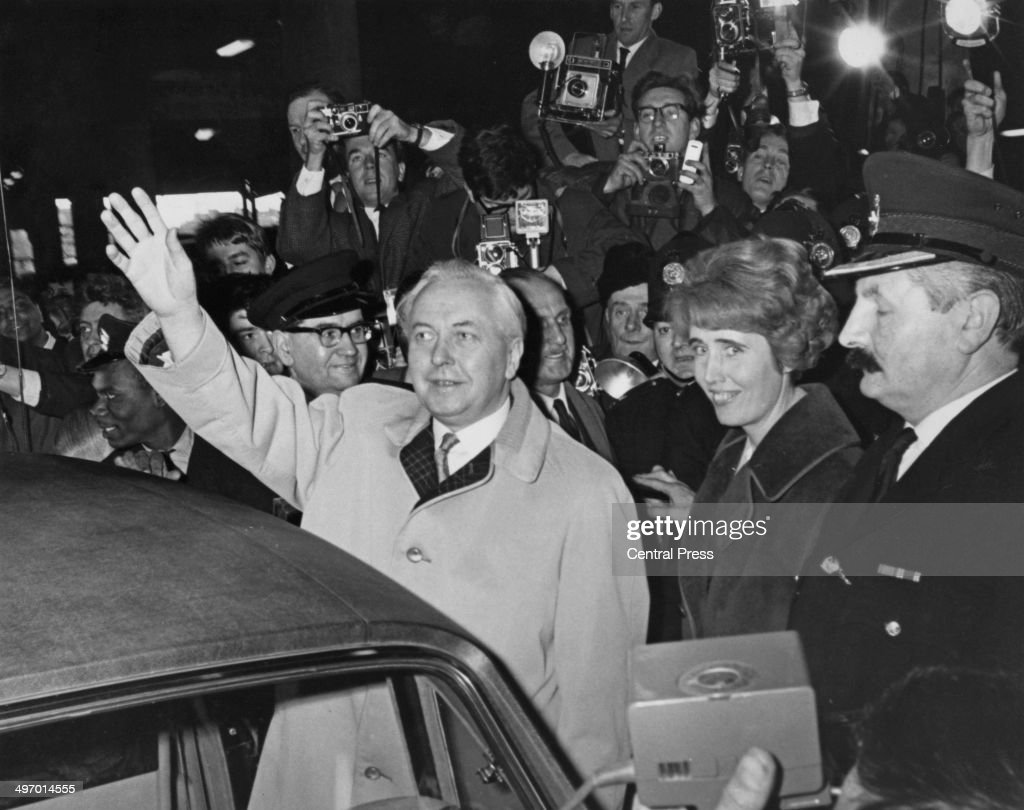 British Prime Minister Harold Wilson (1916 - 1995) leaving Euston Station, London, on his return from Liverpool, where he retained his Huyton seat in the general election, 1st April 1966. Wilson's Labour Party won the election with a 96-seat majority. With Wilson (right) is his political secretary Marcia Williams (now Marcia Falkender, Baroness Falkender).