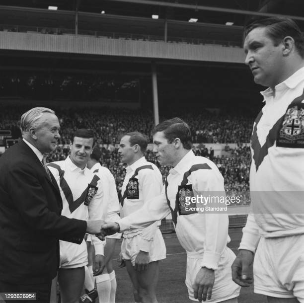 British Prime Minister Harold Wilson shakes hands with the St Helens RFC rugby team during the Rugby League 1965-66 Challenge Cup final at Wembley...