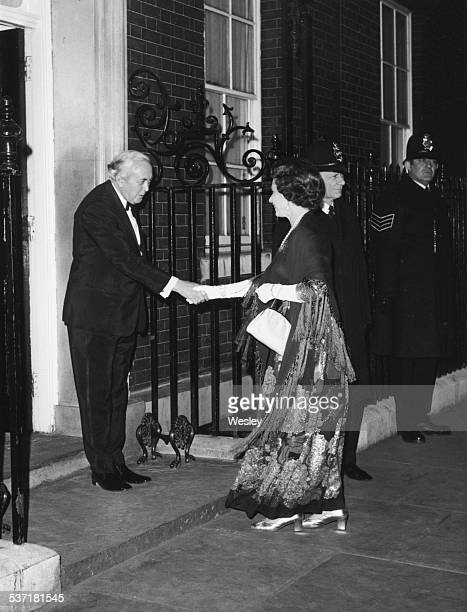 British Prime Minister Harold Wilson shaking hands with Queen Elizabeth II outside 10 Downing Street following his resignation London March 24th 1976
