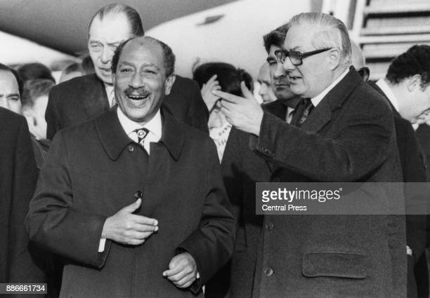 British Prime Minister James Callaghan greets Anwar Sadat the President of Egypt upon his arrival at London Airport UK 9th February 1978 Sadat is in...