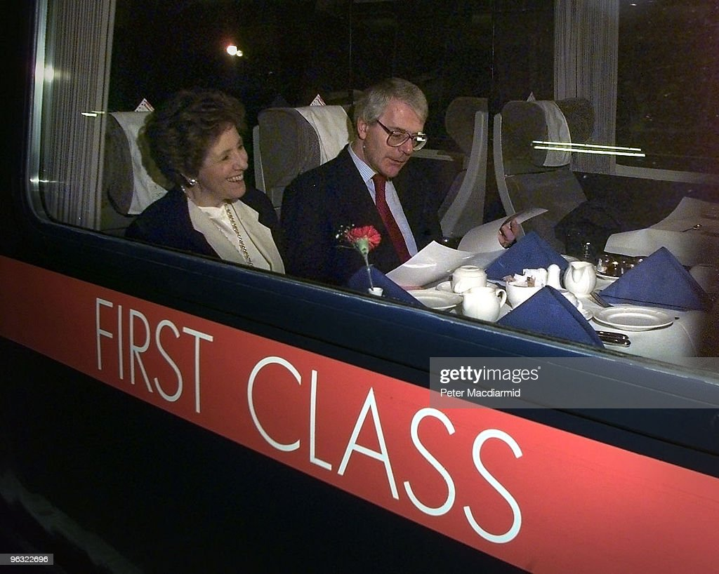 British Prime Minister John Major and his wife Norma on a train at King's Cross Station, London, bound for Teeside, 21st February 1997.