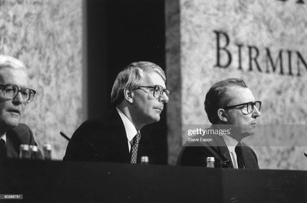 British prime minister John Major, centre, with foreign secretary Douglas Hurd, left, and president of the European Commission Jacques Delors, at the EC summit in Birmingham, October 1992.