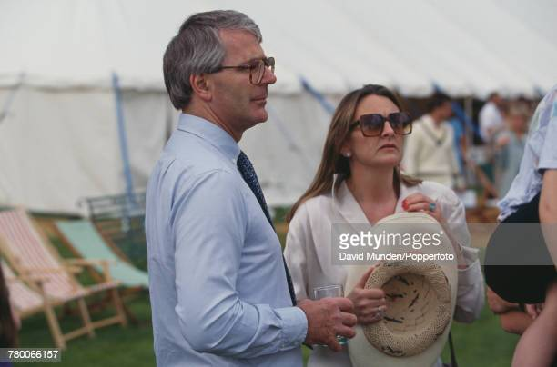British Prime Minister John Major with writer Frances Edmonds at the first match to be played at John Paul Getty Jr's new cricket ground on his...
