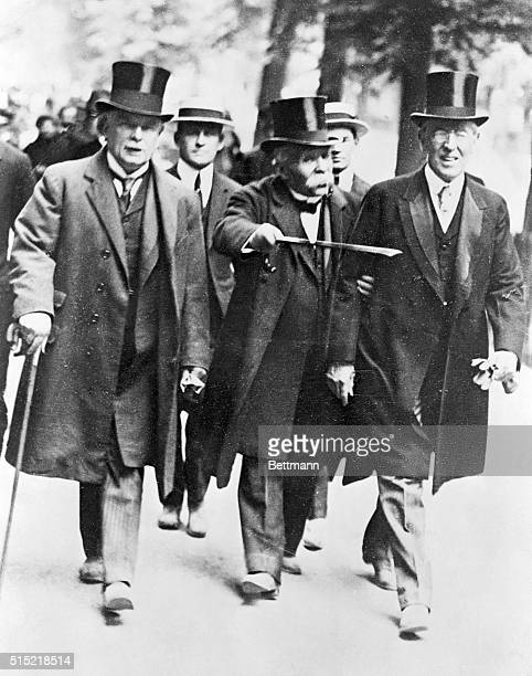 British Prime Minister Lloyd George, French Premier Georges Clemenceau, and U.S. President Woodrow Wilson walk together in Paris during negotiations...