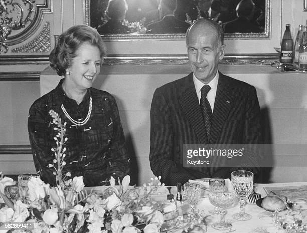 British Prime Minister Margaret Thatcher and French President Valery Giscard sitting together at a dinner in the Elysee Palace, Paris, circa 1980.