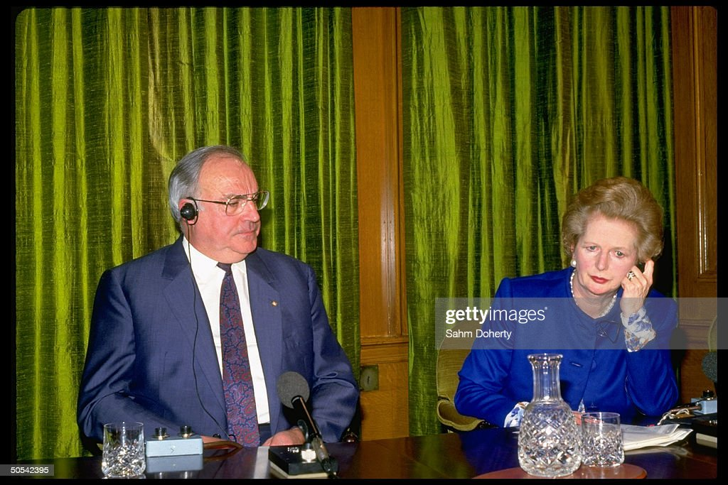 British Prime Minister Margaret Thatcher and German Chancellor Helmut Kohl at press conference.