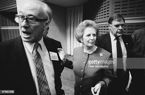 British Prime Minister Margaret Thatcher and her husband Denis attend the 'Saving the Ozone Layer' conference in the Queen Elizabeth II Conference...