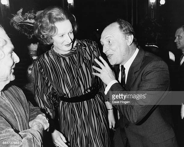 British Prime Minister Margaret Thatcher and Labour Party Leader Neil Kinnock attending a gala charity performance of 'The Mystery of Edwin Drood' in...