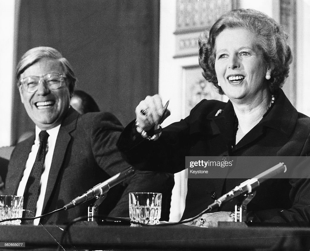 British Prime Minister Margaret Thatcher and West German Chancellor Helmut Schmidt laughing as they are asked if their two countries are now friends, at a press conference at Chequers, England, May 13th 1981.
