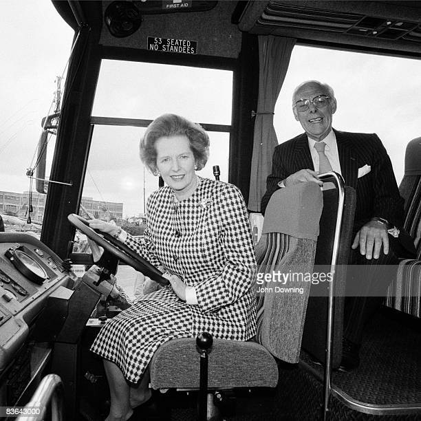 British prime minister Margaret Thatcher at the wheel of a coach with her husband Denis during the general election campaign 22nd May 1978