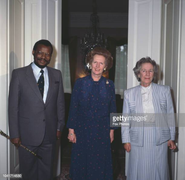British Prime Minister Margaret Thatcher greets South African MPs Helen Suzman and Mangosuthu Buthelezi Chief Minister of KwaZulu and President of...