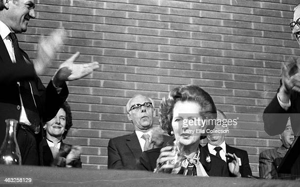British Prime Minister Margaret Thatcher in Farnborough UK circa 1980 Her husband Denis Thatcher is behind