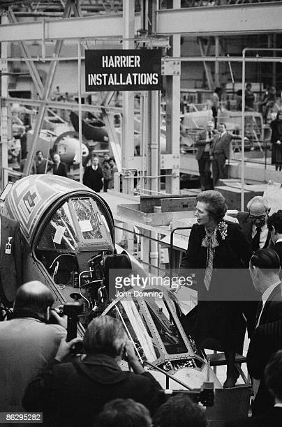 British Prime Minister Margaret Thatcher inspects a Sea Harrier aircraft during a visit to the British Aerospace factory at Dunsfold Surrey 18th...