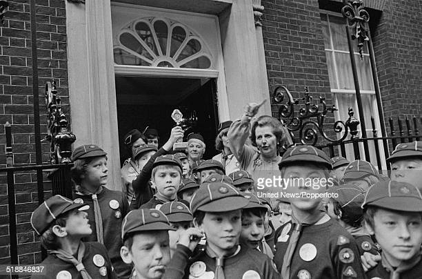 British Prime Minister Margaret Thatcher meets a pack of Cub Scouts from Wakefield on the steps of Ten Downing Street in London on 24th October 1979
