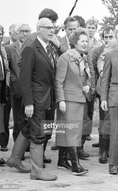 British prime minister Margaret Thatcher on the campaign trail at a farm in Kent with her husband Denis circa 1987