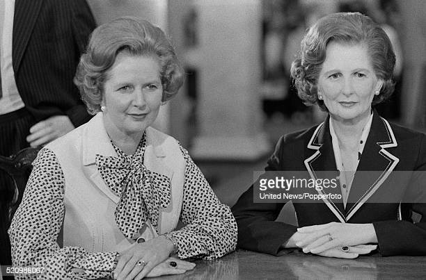 British Prime Minister Margaret Thatcher pictured on left with her waxwork at Madame Tussauds wax museum in London on 28th May 1980